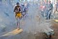 aboriginal dancers with smoke