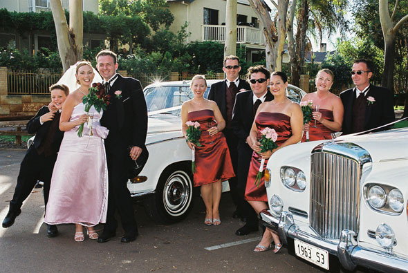 wedding photo with rolls royce backdrop