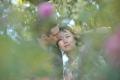 couple-through-trees