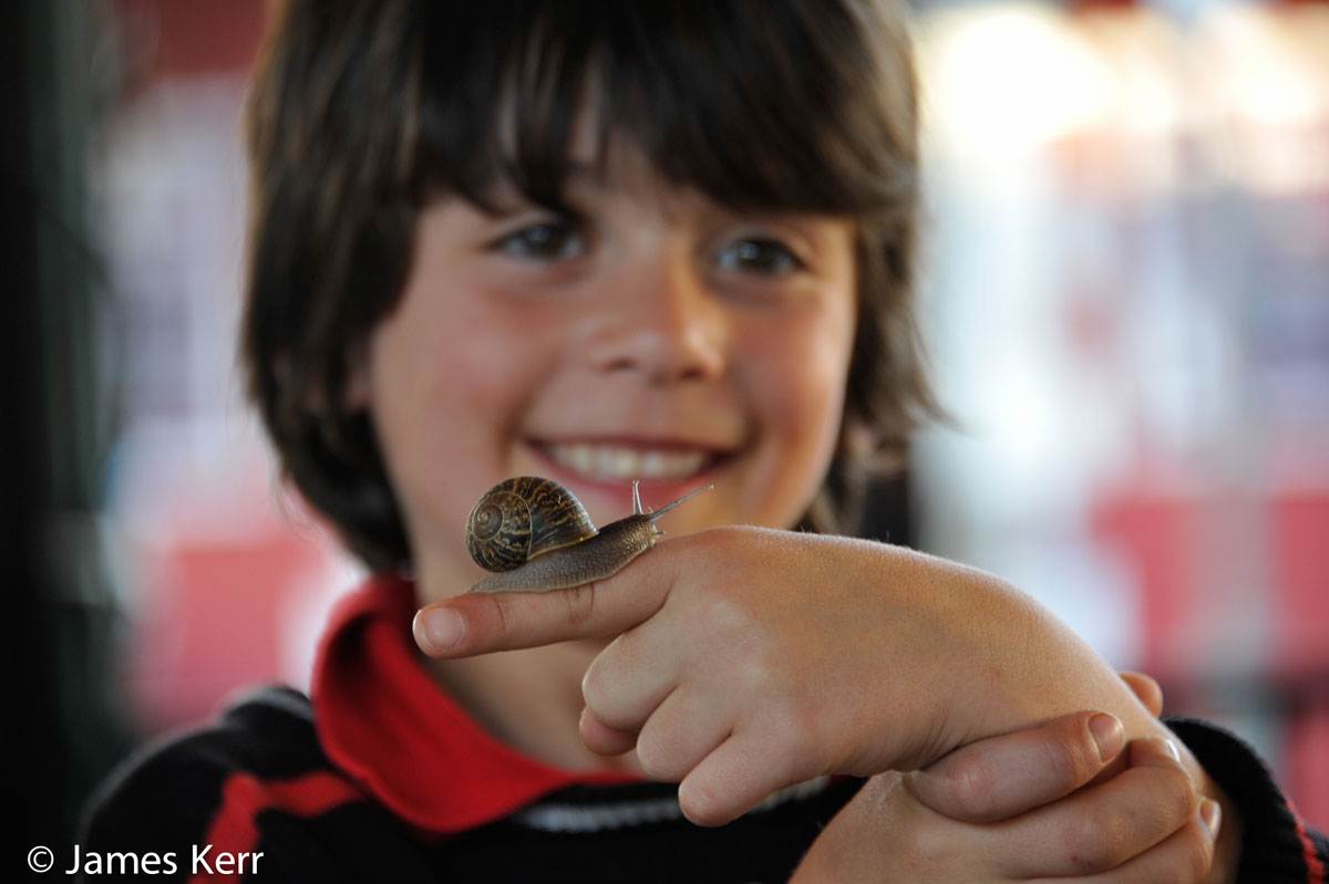 boy with snail on finger